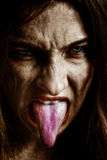evil-scary-sinister-woman-tongue-out-11030656